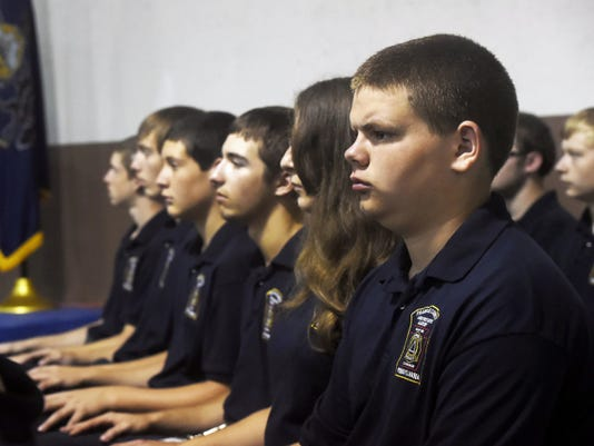 Franklin County junior firefighters sit at attention during their graduation on Saturday. The cadets between ages 14 and 17 participated in the Franklin County Junior Firefighters Academy, where they received training, and visited fire houses and the National Fire Academy in Emmitsburg, Maryland.