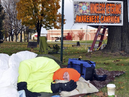 Huddled in his sleeping bag, Eric Lindinger naps in Fisher Veterans Park in Lebanon on Friday afternoon. The Lebanon man was one of the participants in the Lebanon VFW's third annual Homeless Veterans Awareness Campaign.