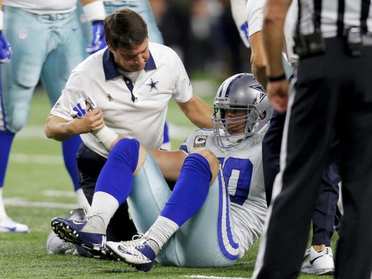 Dallas Cowboys linebacker Sean Lee is assisted by team staff after suffering a recent injury. The former Penn State standout is one of a number of NFL players dealing with concussion issues this season.