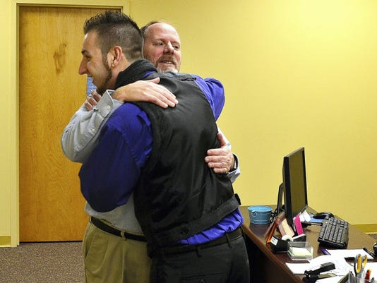 Jacob Ruth, left, greets Pastor Jeff Smith at Grace Fellowship Church in Shrewsbury on Sunday, Feb. 8. Ruth tells his story in a video at yorkdispatch.com.