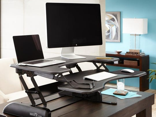 The Varidesk Prop Plus 26 is a height-adjustable desk that sits on top of your regular desk.
