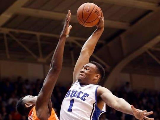 Duke's Jabari Parker (1) drives to the basket as Syracuse's Rakeem Christmas defends during the second half of an NCAA college basketball game in Durham, N.C., Saturday, Feb. 22, 2014. Duke won 66-60. (AP Photo/Gerry Broome)