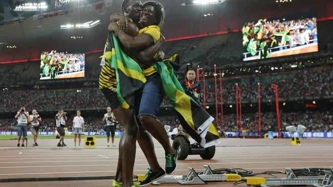 Jamaica's Usain Bolt hugs his mom, Jennifer Bolt, after winning the men's 100-meter final at the World Athletics Championships last August in Beijing.