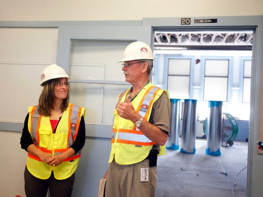 Christy Perry, the new Salem-Keizer schools superintendent, left, and Bruce Lathers, manager of construction services, chat during a tour of Highland Elementary, which is having extensive work done over the summer, Monday June 30, 2014.