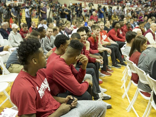 Players watch as Archie Miller, new head coach of Indiana University's men's basketball team, is introduced in Assembly Hall, Monday.