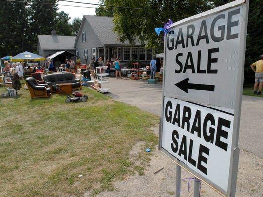 A pair of signs point potential customers to a home on M-25 during the Antique and Yard Sale Trail. This year's Antique and Yard Sale Trail is Aug. 14-16 along M-29 and M-25 in several communities from Port Huron to Sebewaing.
