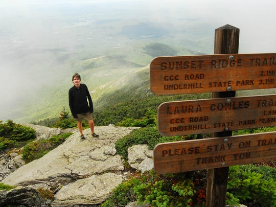 Mark Kelley of Burlington stands at the head of the Laura Cowles trail near the top of Mount Mansfield on Thursday. Kelley says he has logged106 combined ascents of Mansfield and Camel's Hump this season, the fourth straight year with triple-digit summits of Vermont's highestpeaks.