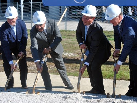 Daily's President and CEO Aubrey Edge, left, Jacksonville Jaguars NFL football team owner Shad Khan, Jacksonville Mayor Lenny Curry and Jaguars President Mark Lamping, right, break ground on the second phase of a $90 million upgrade to EverBank Field in Jacksonville, Fla., Friday Aug. 19, 2016. The new complex called Daily's Place, will feature an amphitheater and a multi-use indoor practice facility.   (AP Photo/Mark Long)