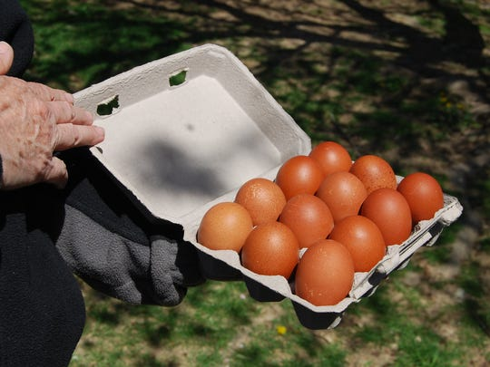 Lee Strohm's French maran chickens lay large dark brown eggs that have low cholesterol but high amounts of vitamins A and D.