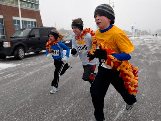 Runners brave the snow and wind for the Jingle Bell Run at the YMCA of the Blue Water Area. This year's race is Saturday, Dec. 6, and registration is open.