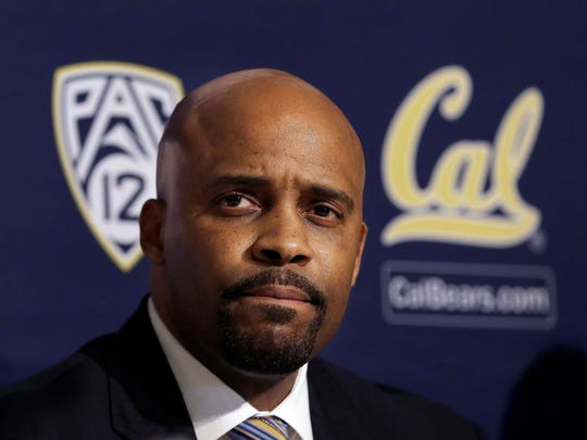Cuonzo Martin sits at a news conference as he is introduced as the new men?s basketball coach at California in Berkeley, Calif., April 15, 2014.