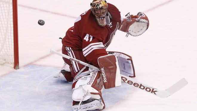 Arizona Coyotes goalie Mike Smith makes a save against the Buffalo Sabres during the first period at Gila River Arena in Glendale on March 30, 2015.