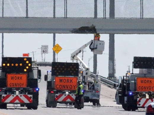 Excavator on trailer hits pedestrian bridge on US 54