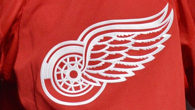 The Detroit Red Wings' Winged Wheel on a sweater.