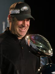 Eagles head coach Doug Pederson looks down at the Vince Lombardi Trophy at the start of a press conference Monday morning at the Mall of America in Minneapolis, Minn.