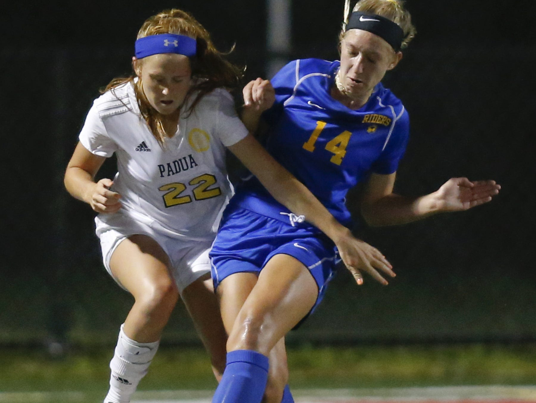 Padua's Mackenzie Scully (left) and Caesar Rodney's Kimberly Glasser vie for possession in DIAA Division I state title game at Smyrna High.