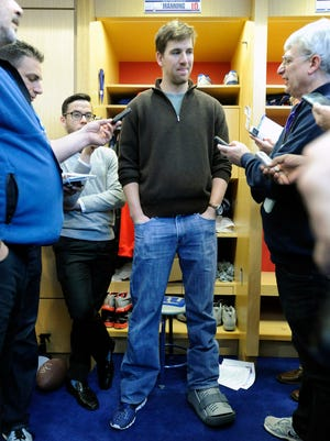 Giants quarterback Eli Manning speaks to the media with a walking boot on his left foot Dec. 30 after injuring his ankle in the last game of the season against the Washington Redskins.