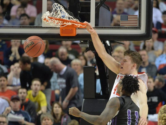 Utah center Jakob Poeltl dunks against Stephen F. Austin
