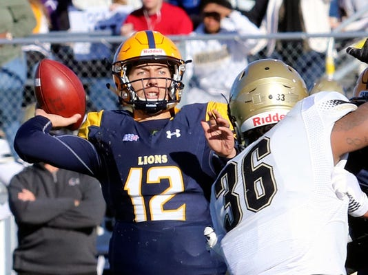 Texas A&M-Commerce quarterback Luis Perez (12) throws under pressure from Harding defender Shedrick Robinson during an NCAA Division II college football game in Commerce, Texas, Saturday, Dec. 9, 2017.  Texas A&M-Commerce quarterback Luis Perez and Gannon running back Marc Jones highlight The Associated Press Division II All-America team. The team was selected by a panel of sports information directors from around the country. Perez leads D-II in yards passing with 4,390 yards and has thrown 42 touchdowns. The senior has guided Texas A&M-Commerce to the Division II national championship game, where it will play West Florida on Saturday in Kansas City, Kansas. (John Markon/The Herald-Banner via AP)