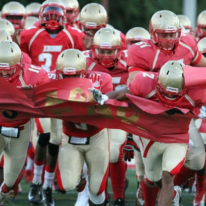 The Edison High School football team takes the field