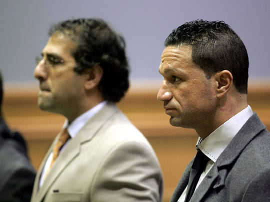 Marc Sorrentino (right), brother of   Mike 'The Situation' Sorrentino, appears in Howell   Municipal Court in 2011 with   attorney Raymond Raya on a simple assault charge.