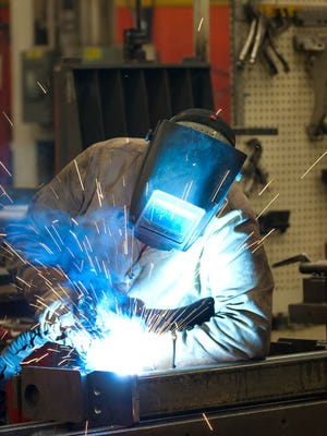 A Raymond Corp. employee in Greene, N.Y. welds the forks of a lift truck. The Chenango County manufacturer of warehouse equipment has helped this largely rural county record a more than 40 percent increase in production employment over the past six years, in stark contrast to the 3 percent statewide decline in manufacturing jobs over the past six years.