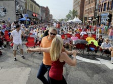 Lisa Lockwood and Don Neu dance during a Chris Hawkey Band performance during the 2014 Takin' It To The Streets Festival.