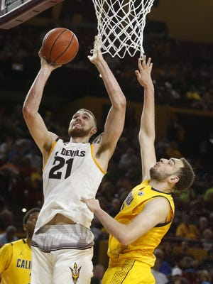 Arizona State's Eric Jacobsen goes up for a shot while being guarded by California center Kameron Rooks during a men's basketball game at Wells Fargo Arena in Tempe on Saturday, March 5, 2016.