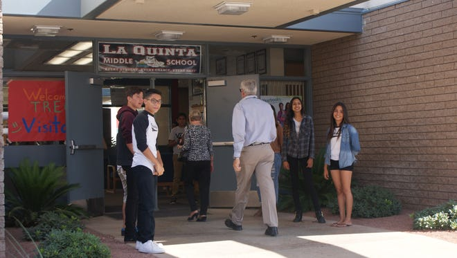 La Quinta Middle School students welcome community leaders to campus for a tour.