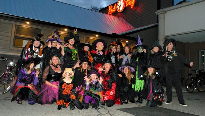"""The """"witches"""" gathered for a photo outside their final destination at the Red Dog Saloon."""