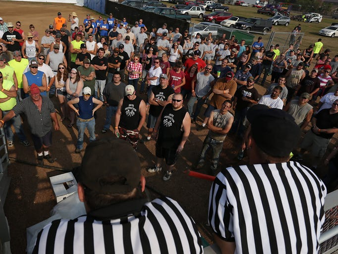 Daily Herald Media visual journalist Dan Young photographed some of the faces in the drivers' crowd and the general crowd during Demolition Derby action at the Wisconsin Valley Fair in Wausau, Sunday, August 3, 2014.
