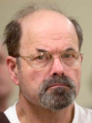 In this Oct. 12, 2005, file photo, convicted BTK killer Dennis Rader listens during a court proceeding in El Dorado, Kan.
