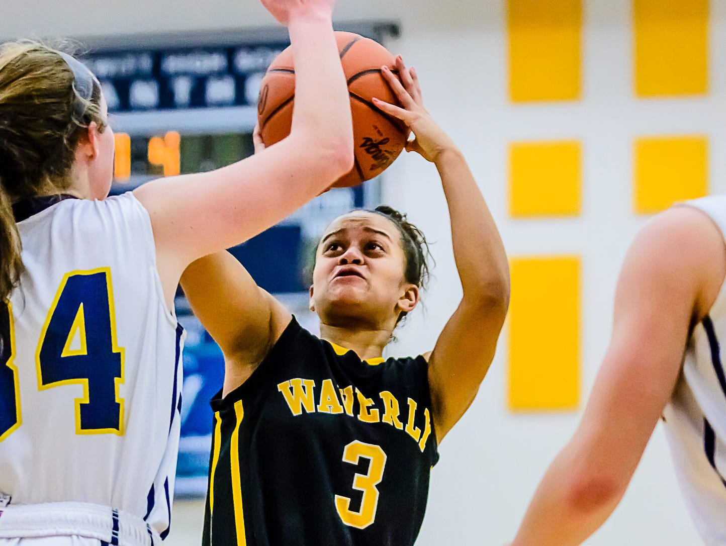 Jazlynn Wilcox ,3, of Waverly shoots over Grace George of DeWitt during their game Friday January 6, 2017 in DeWitt. KEVIN W. FOWLER PHOTO