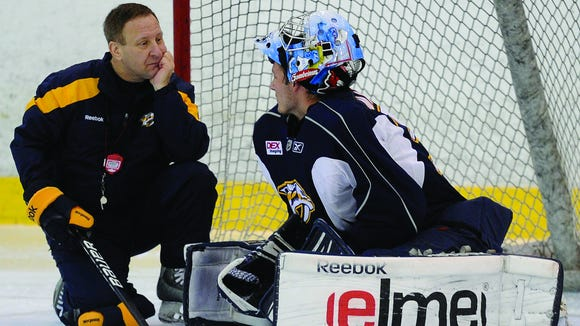 Goaltending coach Mitch Korn with goalie Marek Mazanec last year during Predators development camp.