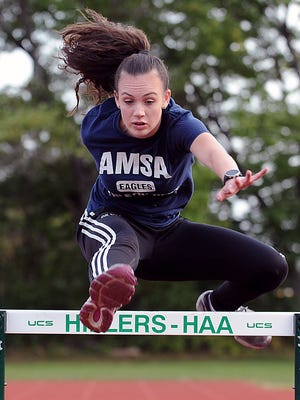 AMSA senior Allison Silva of Marlborough practices at the Hopkinton High School track Tuesday.