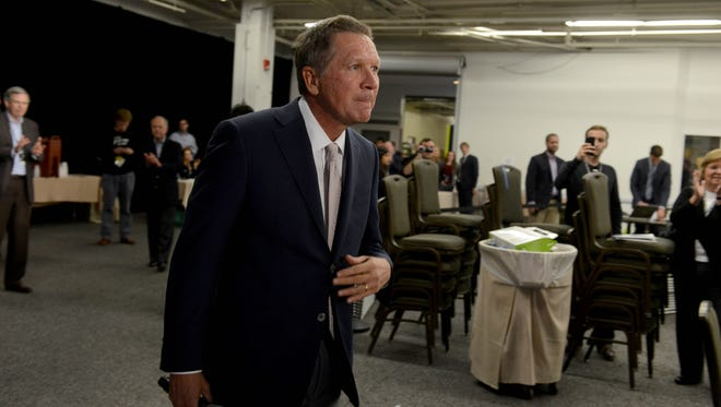 John Kasich prepares to speak at the No Labels Problem Solver Convention Monday in Manchester, New Hampshire.