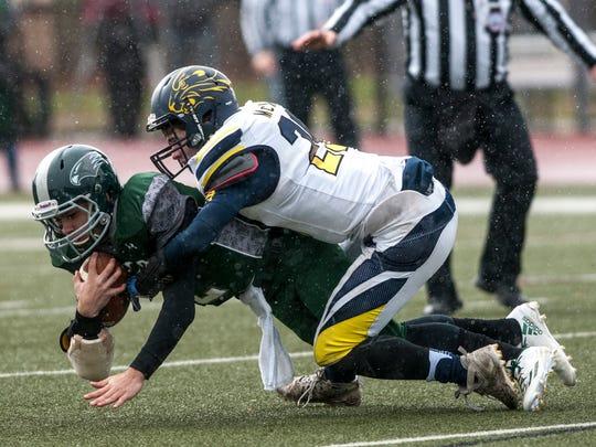 Algonac's Joe McKee sacks West Catholic's Gaetano Vallone during a Division 5 semifinal football game Saturday, Nov. 19, 2016 at Harper Creek High School in Battle Creek.