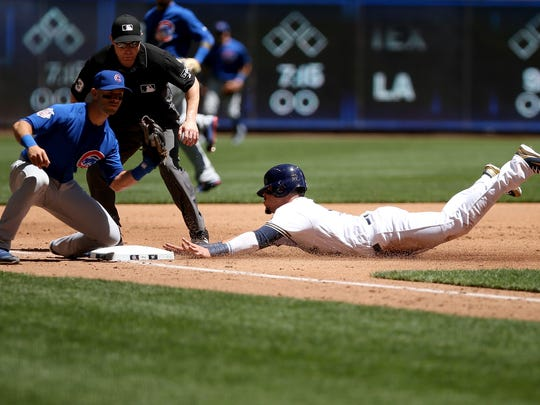 Hernan Perez of the Brewers slides into third for a stolen base against Tommy La Stella of the Cubs.