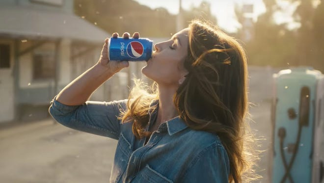 Cindy Crawford reprises her role from a classic Pepsi ad.