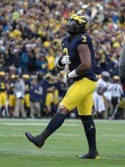 Michigan's Rashan Gary celebrates after a sack against Ohio State in the third quarter on Saturday, Nov. 25, 2017 at Michigan Stadium.