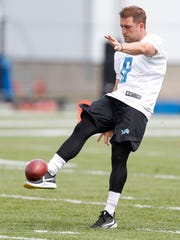 Detroit Lions punter Sam Martin (6) punts the ball