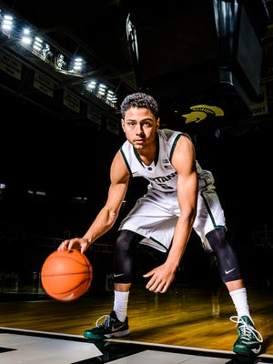 Bryn Forbes poses during Michigan State basketball media day Tuesday, Oct. 28, 2014, at the Breslin Center in East Lansing.