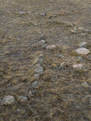Rocks positioned on the prairie are believed to be a human effigy with spiritual significance at an archeological site on BLM land near Malta.