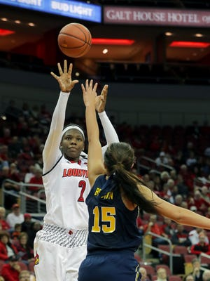 Louisville's Myisha Hines-Allen takes a shot over Michigan's Hailey Brown.