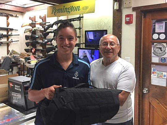 St. Augustine Prep senior Michael Rebbecchi (left) is shown after purchasing three protective vests from Greg Isabella of the Firing Line Inc, in Philadelphia. The money for the vests was raised through generous donations to a community project called Operation K-9 Kevlar that Rebbecchi started and ran with fellow student Devon Osgood. The vests were presented to the Gloucester Township Police Department recently.