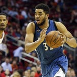 Minnesota Timberwolves center Karl-Anthony Towns (32) dribbles the ball during the second half against the Houston Rockets at Toyota Center. The Rockets won 116-111.