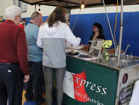 Gabriella Tomasello of Mannino's Cannoli Express serves