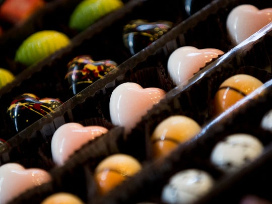 Chocolate samples are offered to the residents of the Carlisle Naples from Norman Love Confections Thursday, June 22, 2017 in Naples.
