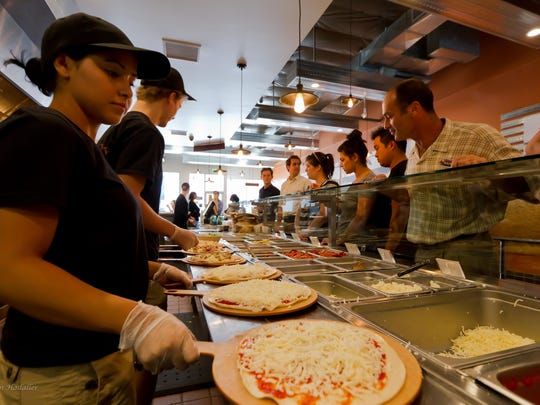 PizzaRev is a build-your-own pizza restaurant that makes 11-inch pies in front of customers.