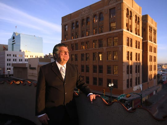 "William ""Billy"" Abraham stands with his Caples Building behind him. The mostly vacant building, at 300 E. San Antonio Ave., is part of Abraham's large property portfolio."